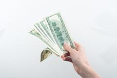 Девушка сказала 10000 долларов в руке Стоковое фото RF