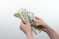 Девушка сказала 10000 долларов в руке Стоковые Изображения RF