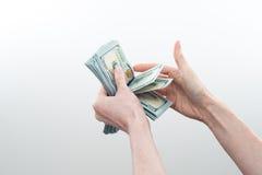 Девушка сказала 10000 долларов в руке Стоковые Фото