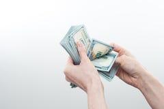 Девушка сказала 10000 долларов в руке Стоковое Фото
