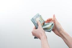 Девушка сказала 10000 долларов в руке Стоковое Изображение
