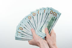 Девушка сказала 10000 долларов в руке Стоковые Фотографии RF