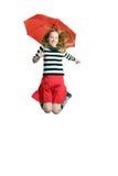 Девушка скача с зонтиком стоковое изображение
