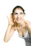 девушка слушая довольно что-то к стоковые изображения rf