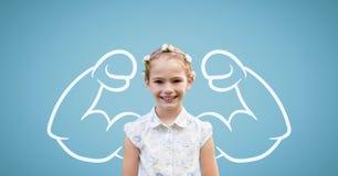 Девушка студента при график кулаков стоя против голубой предпосылки Стоковая Фотография RF