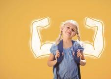 Девушка студента при график кулаков стоя против желтой предпосылки Стоковая Фотография