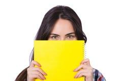 Девушка студента с книгами на белизне Стоковая Фотография