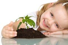 девушка счастливая ее маленький завод Стоковое Изображение RF