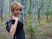 Девушка с ботинками в руке Стоковая Фотография