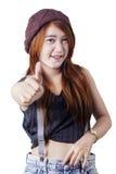 Девушка с большим пальцем руки выставки вскользь одежд вверх Стоковое Изображение RF