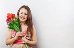 Девушка с букетом стоковое фото
