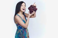 Девушка с виноградиной Стоковая Фотография
