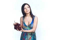 Девушка с виноградиной Стоковые Изображения