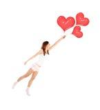 Девушка с воздушными шарами сердца Стоковое Фото