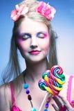 Девушка с леденцом на палочке стоковое фото rf