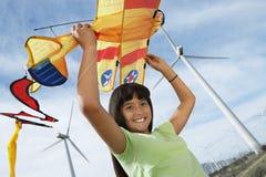 Девушка с змеем самолета на ветровой электростанции Стоковые Изображения