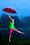 Девушка с зонтиком в дожде Стоковое Изображение