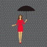 Девушка с зонтиком в дожде стоковое фото rf