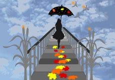 Девушка с зонтиком идя на пристань Стоковое фото RF