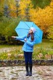 Девушка с зонтиком Стоковое фото RF