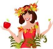 Девушка с листьями и яблоком осени Стоковое Изображение RF