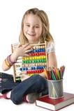 Девушка с книгами и абакусом Стоковая Фотография