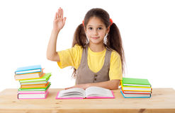 Девушка с книгами и повышениями его рука вверх Стоковые Изображения RF