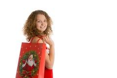 Девушка с концом хозяйственной сумки рождества вверх Стоковые Изображения