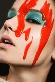 Девушка с краской на ее стороне Стоковое Изображение RF