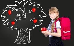 Девушка с красным яблоком Стоковое Изображение RF