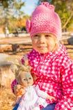 Девушка с куклой Стоковое Изображение RF
