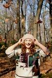 Девушка с листьями стоковое изображение rf