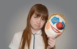 Девушка с маской клоуна Стоковое фото RF