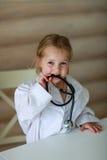 Девушка с доктором стетоскопа Стоковое фото RF
