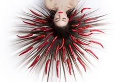 Девушка с перцами чилей Стоковые Фото