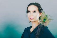 Девушка с пер павлина Стоковое фото RF