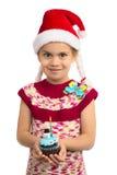 Девушка с пирожным праздника стоковое изображение