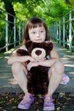 Девушка с плюшевым медвежонком Стоковая Фотография RF