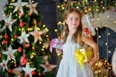 Девушка с подарками рождества Стоковое фото RF