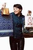 Девушка с покупками в сумках, Shopaholic, пакетами с вещами Стоковое Фото