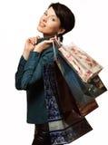 Девушка с покупками в сумках, Shopaholic, пакетами с вещами Стоковые Изображения RF