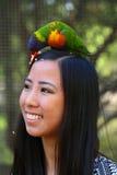 Девушка с птицей стоковая фотография rf