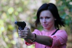 Девушка с пушкой стоковая фотография rf