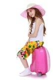 Девушка с розовым чемоданом стоковые изображения