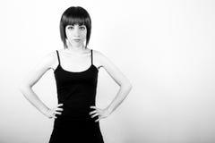 Девушка с руками на вальмах Стоковая Фотография