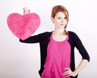 Девушка с сердцем игрушки. стоковое фото