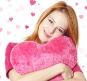 Девушка с сердцем игрушки стоковое изображение