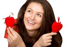 Девушка с сердцами игрушки Стоковая Фотография