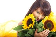 Девушка с солнцецветами Стоковое Фото