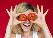 Девушка с томатами стоковое фото